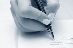 Businesswoman signing the contract. Stock Photography