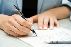 Business woman signing contract Stock Photography