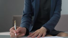 Businesswoman signing contract for buying or renting office, agency service. Stock footage stock footage