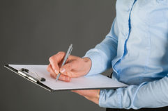 Businesswoman signing a contract Stock Image