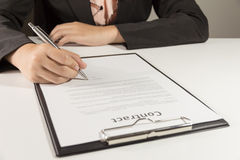 Businesswoman signing contract document Royalty Free Stock Photo