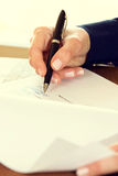 Businesswoman signing a contract Stock Photos