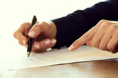 Businesswoman signing a contract. With a pen Royalty Free Stock Photo