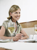 Businesswoman Signing Contract In Restaurant Royalty Free Stock Images
