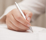 Businesswoman signing contract Stock Image
