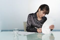 Businesswoman Signing Contract Royalty Free Stock Photo
