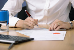 Businesswoman signing document Stock Photos