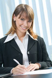 Businesswoman signing document Royalty Free Stock Photos