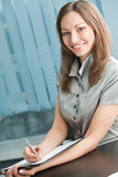 Businesswoman signing document Stock Image