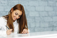 Businesswoman signing document Stock Images