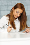 Businesswoman signing document Royalty Free Stock Photo