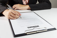 Businesswoman signing insurance document royalty free stock photography