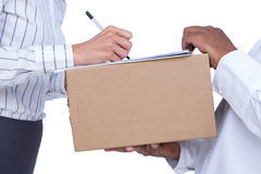 Businesswoman signing papers for package Stock Photography