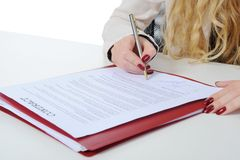 Businesswoman signs a contract Stock Photos