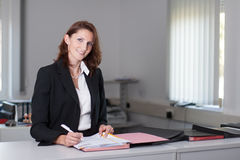 Businesswoman signs contract Stock Images
