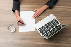 Businesswoman signs document Royalty Free Stock Photography