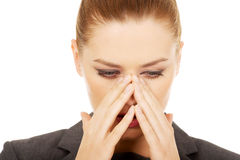 Businesswoman with sinus pain. Royalty Free Stock Images
