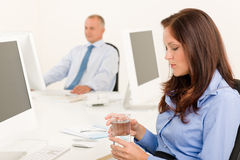 Businesswoman sit in office hold water glass Stock Photography