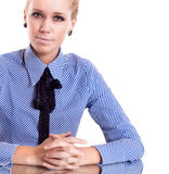 Businesswoman siting on reflection table Royalty Free Stock Image