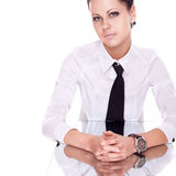 Businesswoman siting on reflection table Royalty Free Stock Photo