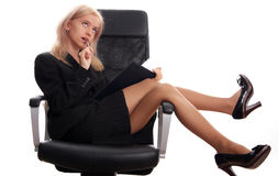 Businesswoman sits on a chair with the handle Stock Photography
