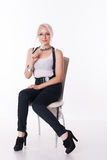 Businesswoman sits on a chair. With the handle at the white background royalty free stock photos