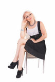 Businesswoman sits on a chair. With the handle at the white background stock images
