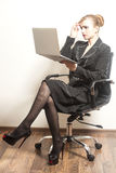 Businesswoman sits on chair and work Stock Image