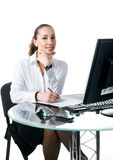 Businesswoman sits at the computer Royalty Free Stock Photo