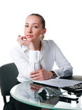 Businesswoman sits at the computer Stock Images