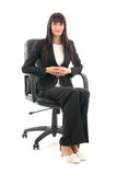 Businesswoman sits in headchair Stock Image