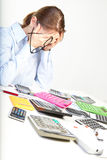 Businesswoman sits at office near calculators Royalty Free Stock Photos
