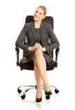 Businesswoman sitting on armchair Royalty Free Stock Images