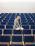 Businesswoman Sitting In Auditorium Royalty Free Stock Image