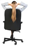 Businesswoman sitting back in office chair with Stock Images