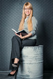 Businesswoman sitting on the barrel Stock Photography