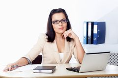 Businesswoman sitting behind the desk stock images