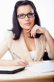 Businesswoman sitting behind the desk Royalty Free Stock Image