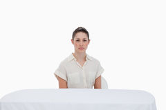 Businesswoman sitting behind a table Royalty Free Stock Images