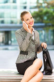Businesswoman sitting on bench outdoors Stock Image