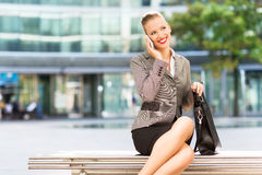 Businesswoman sitting on bench outdoors Royalty Free Stock Photography