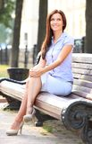 Businesswoman sitting on bench Royalty Free Stock Images