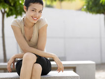 Businesswoman Sitting On Bench In Plaza Royalty Free Stock Photography