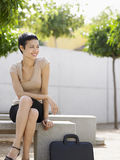 Businesswoman Sitting On Bench In Plaza Royalty Free Stock Images