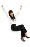 Businesswoman sitting on blank billboard Stock Images