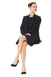 Businesswoman sitting on blank billboard. Royalty Free Stock Images