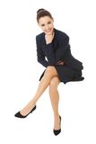Businesswoman sitting on blank billboard. Royalty Free Stock Photos