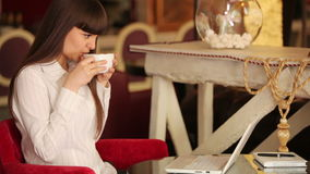 Businesswoman sitting in cafe and drinking coffee stock footage