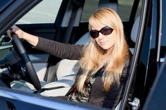 Businesswoman sitting in a car Stock Photos