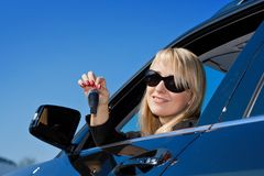 Businesswoman sitting in a car Stock Images